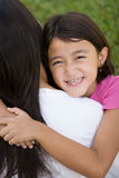 Loving Asain mother and her daughter smiling. Stock Photo