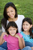 Loving Asain mother and her daughters smiling. Stock Photography