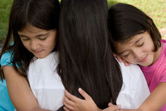 Loving Asain mother and her daughters smiling. Stock Photos