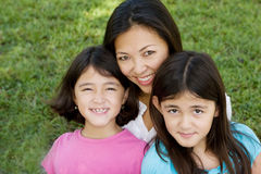 Loving Asain mother and her daughters smiling. Royalty Free Stock Photo