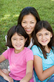 Loving Asain mother and her daughters smiling. Stock Images