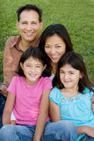 Loving Asain parents and their daughters smiling. Royalty Free Stock Image