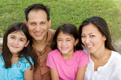 Loving Asain parents and their daughters smiling. Stock Image