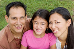 Loving Asain parents and their daughters smiling. Stock Photography