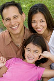 Loving Asain parents and their daughters smiling. Royalty Free Stock Photo