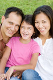 Loving Asain parents and their daughters smiling. Royalty Free Stock Photos