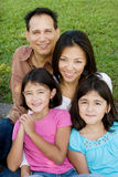Loving Asain parents and their daughters smiling. Stock Photo