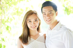 Loving Asian couple in highkey. Asian couple in intimate relationship in high key stock image