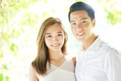 Loving Asian couple in highkey Stock Image