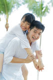 Loving Asian couple on holiday. Royalty Free Stock Images