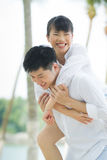Loving Asian couple on holiday. Royalty Free Stock Photography