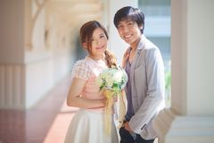 Loving asian couple indoor Royalty Free Stock Image
