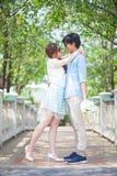 Loving asian couple under tree Stock Photo