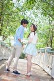 Loving asian couple under tree Royalty Free Stock Photography