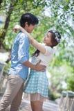 Loving asian couple under tree Stock Images