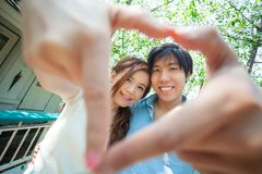 Loving asian couple under tree Stock Images