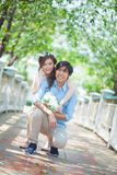 Loving asian couple under tree Royalty Free Stock Images