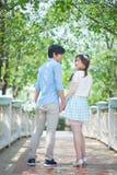 Loving asian couple under tree Royalty Free Stock Photos