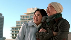 Loving Asian couple in winter clothes posing stock footage