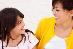 Loving Asian mother and daughter smiling. Stock Image
