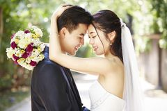 Loving asian newly-wed Stock Photography