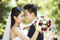 Loving asian newly-wed royalty free stock images