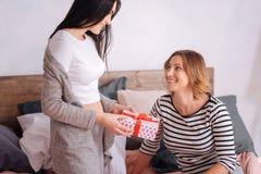 Loving attentive partner making a present Stock Image