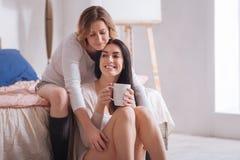 Loving attractive woman hugging her partner Stock Photos