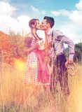 Loving Bavarian couple kiss each other in nature Royalty Free Stock Photo