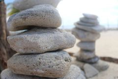 Zen stone at the beach stock images