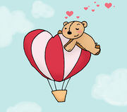 Loving bear on a montgolfier. A loving bear dreams on a heart-shaped montgolfier. Digital colors Royalty Free Stock Image