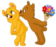 Loving bears. Loving bear kissing his girlfriend and holding bouquet of flowers behind his back Stock Photo