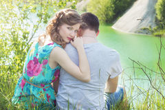 Loving beautiful couple of guys and girls in the field walking man kissing the girls forehead Stock Images