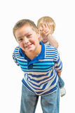 Loving Big Brother Carries Little Brother On His Back Stock Photos