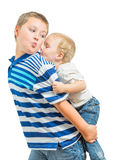 Loving Big Brother Carries Little Brother On His Back Stock Photography