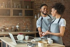 Loving black couple cooking pastry in loft kitchen Stock Photography