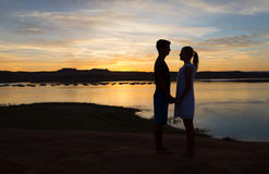 Loving Boy and Girl at Dusk Stock Images