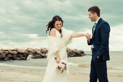 Loving bride and groom near the sea. Royalty Free Stock Image
