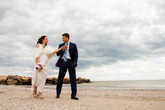 Loving bride and groom near the sea. Royalty Free Stock Photo