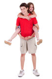 Loving brother gives piggyback Royalty Free Stock Photos
