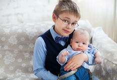 Loving brother holding his little baby brother Royalty Free Stock Image