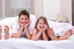 Loving Brother and sister lying and having fun Royalty Free Stock Images