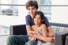 Loving Brother and Sister sit together Royalty Free Stock Images