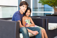 Loving Brother and Sister sit together Stock Photography