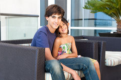 Loving Brother and Sister sit together Stock Photos