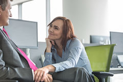 Loving business couple looking at each other in office Royalty Free Stock Images