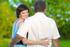 Loving Caucasian Couple Having Time Together Embraced Outdoors in Summer Park Stock Images
