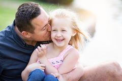 Loving Caucasian Father and Daughter Having Fun At The Park. Young Caucasian Father and Daughter Having Fun At The Park Stock Images