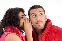Loving caucasian pair whispering a secret Stock Photography