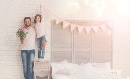 Loving cheerful family welcoming their mom royalty free stock images